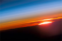 The Earth's climate is a solar powered system. Globally, over the course of the year, the Earth system—land surfaces, oceans, and atmosphe