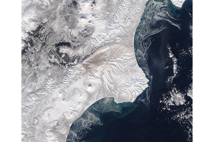 Ash plume and ash on snow from Kizimen, Kamchatka Peninsula, eastern Russia - selected image