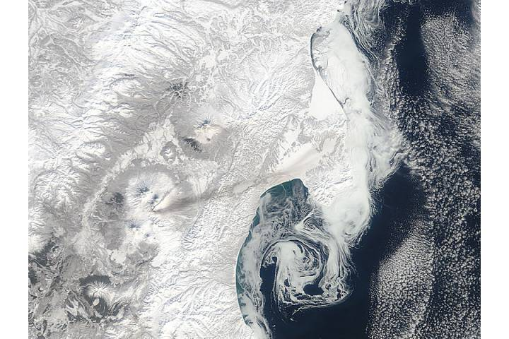 Plume and ash on snow from Bezymianny, Kamchatka Peninsula, eastern Russia - selected image