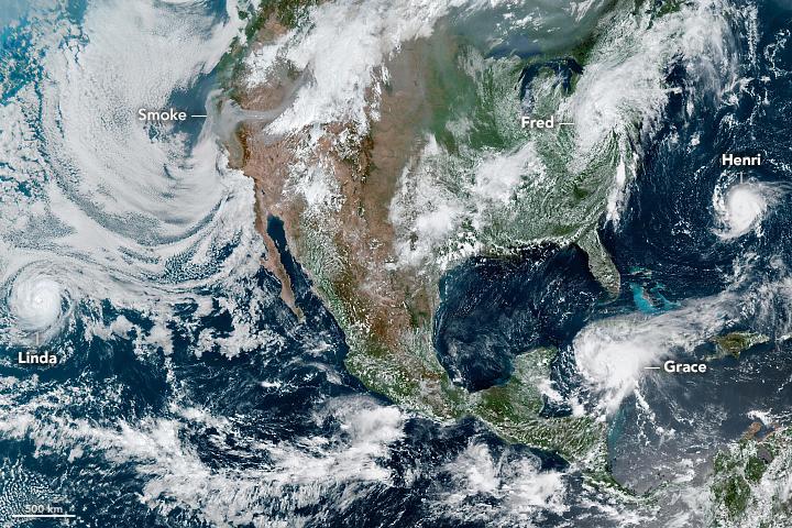 Storms Churn Around North America