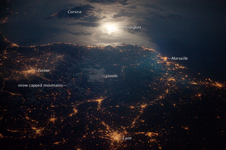 City Lights at Night along the France-Italy Border