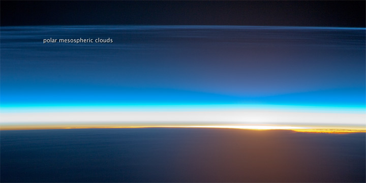 Polar Mesospheric Clouds Illuminated by Orbital Sunrise