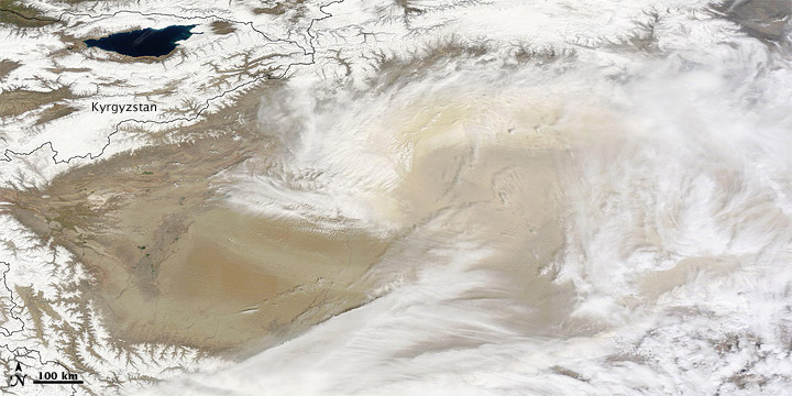 Dust and Clouds over the Taklimakan Desert