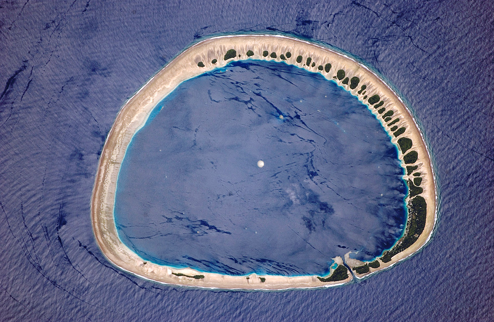 Classically shaped atoll is part of the Caroline Islands, which stretch northeast of Papua New Guinea in the western Pacific