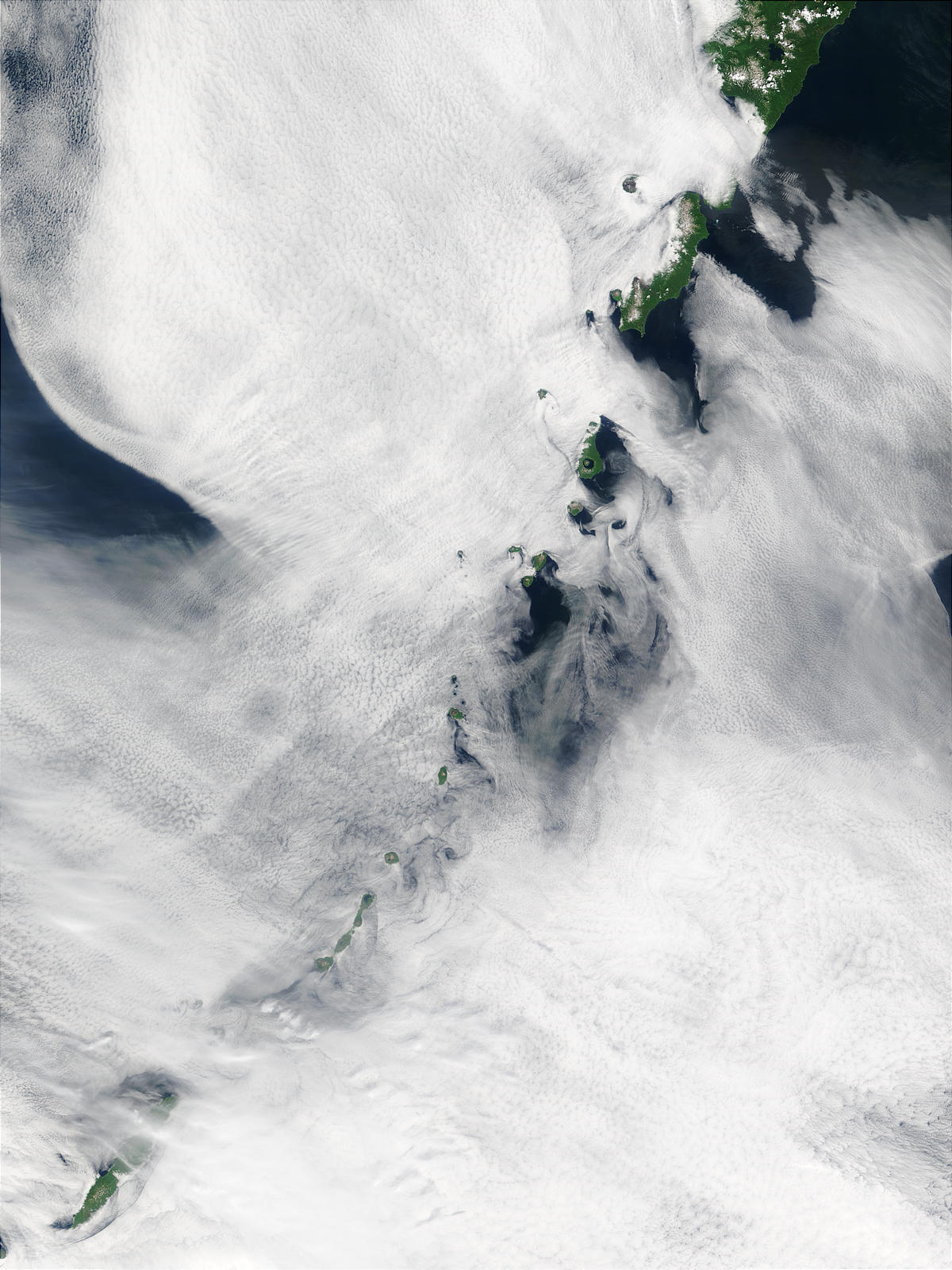 Cloud vortices off Kuril Islands, Russia - related image preview
