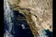 Dust and ash plumes off California
