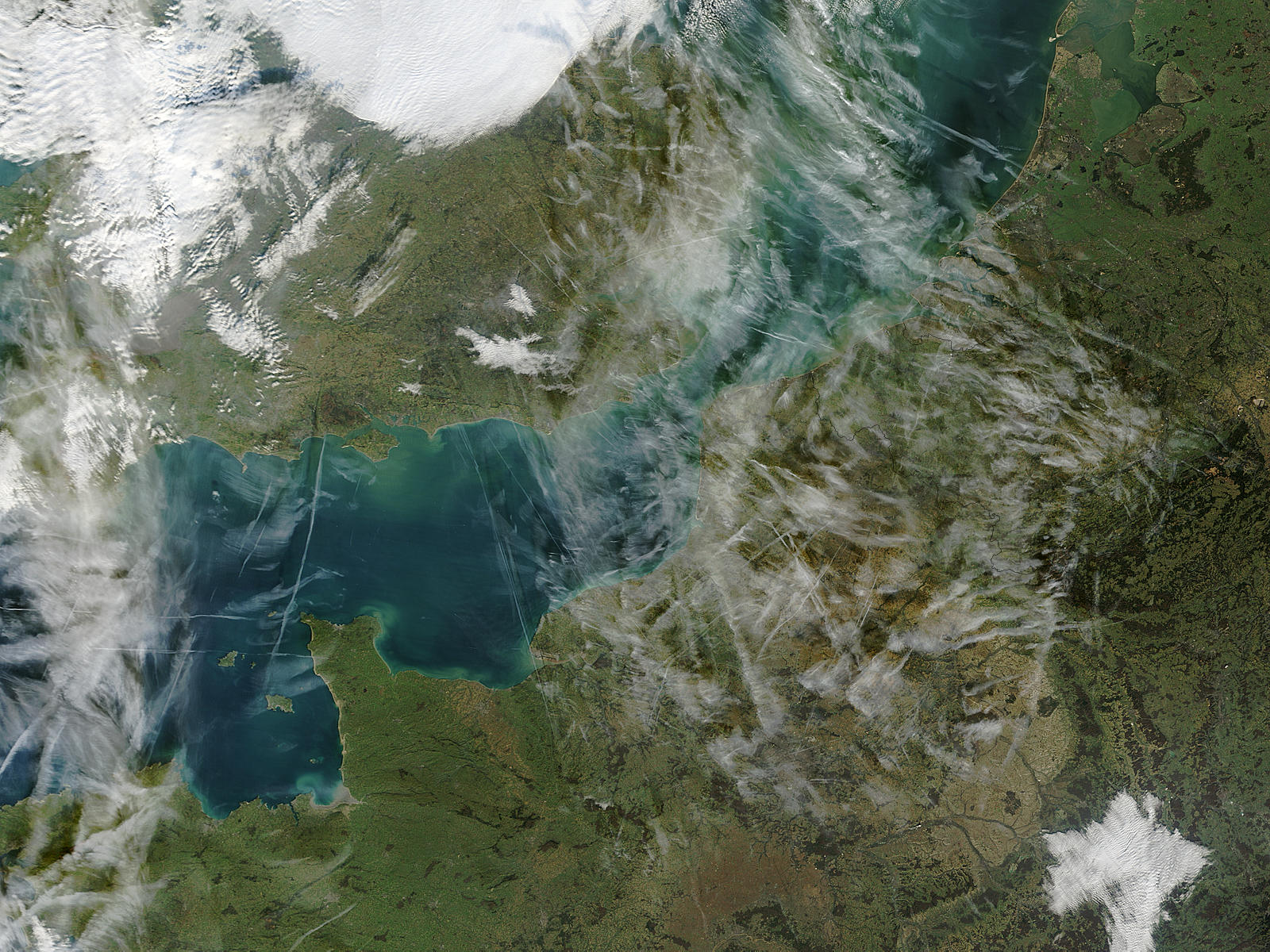 Airplane condensation trails (contrails) across the English Channel - related image preview