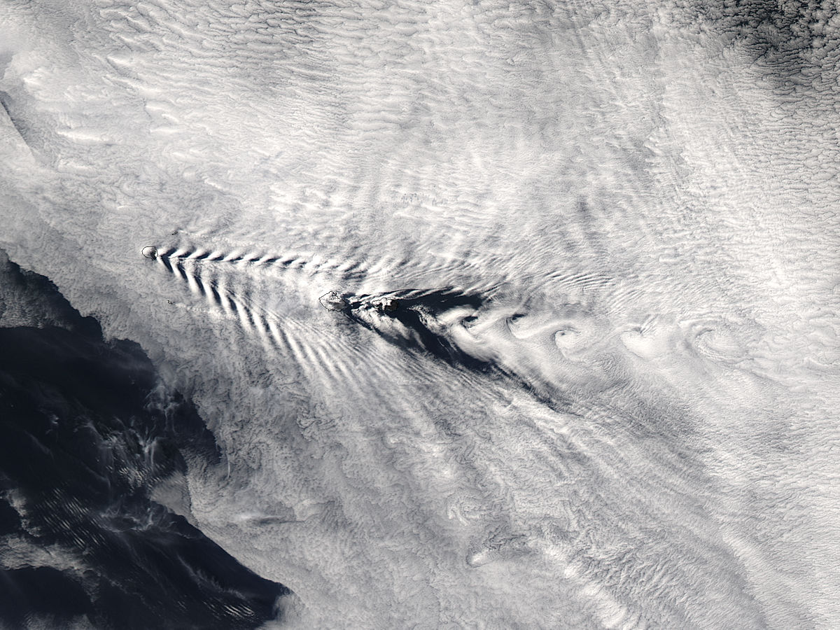 Ship-wave-shaped wave clouds and cloud vortices induced by the Crozet Islands, Indian Ocean - related image preview