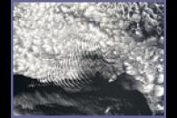 Ship-wave-shaped wave clouds induced by Amsterdam Island, Indian Ocean