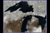 Snow and ice covering the Great Lakes region