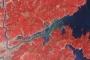Tsunami Sends Kitakami River Far Over Its Banks