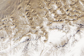 Snow on Sand near Dunhuang, China