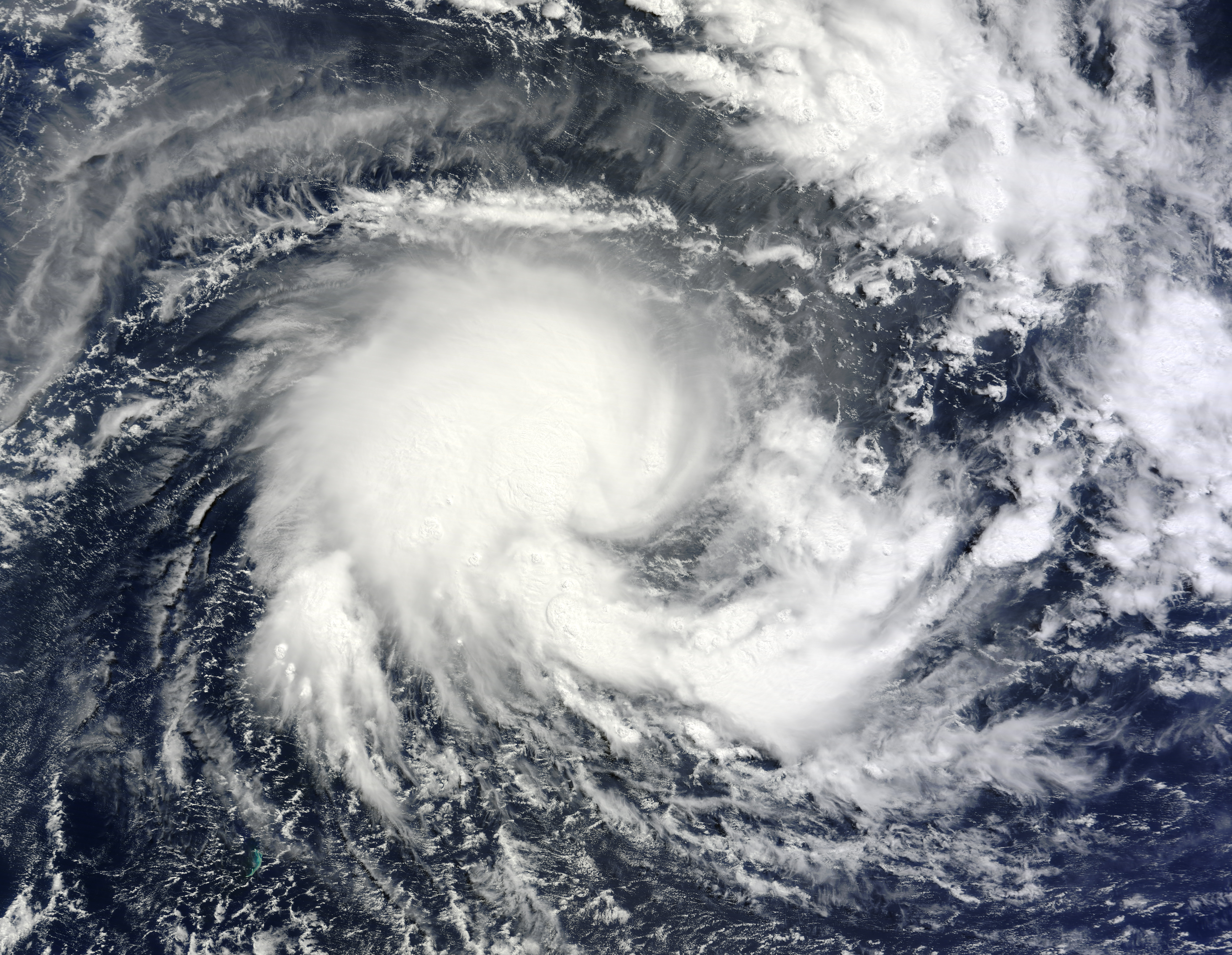 tropical storms Tropical cyclone: tropical cyclone, an intense circular storm that originates over warm tropical oceans and is characterized by low atmospheric pressure, high winds, and heavy rain.