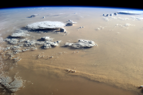 Dust and Clouds Dance Over the Sahara