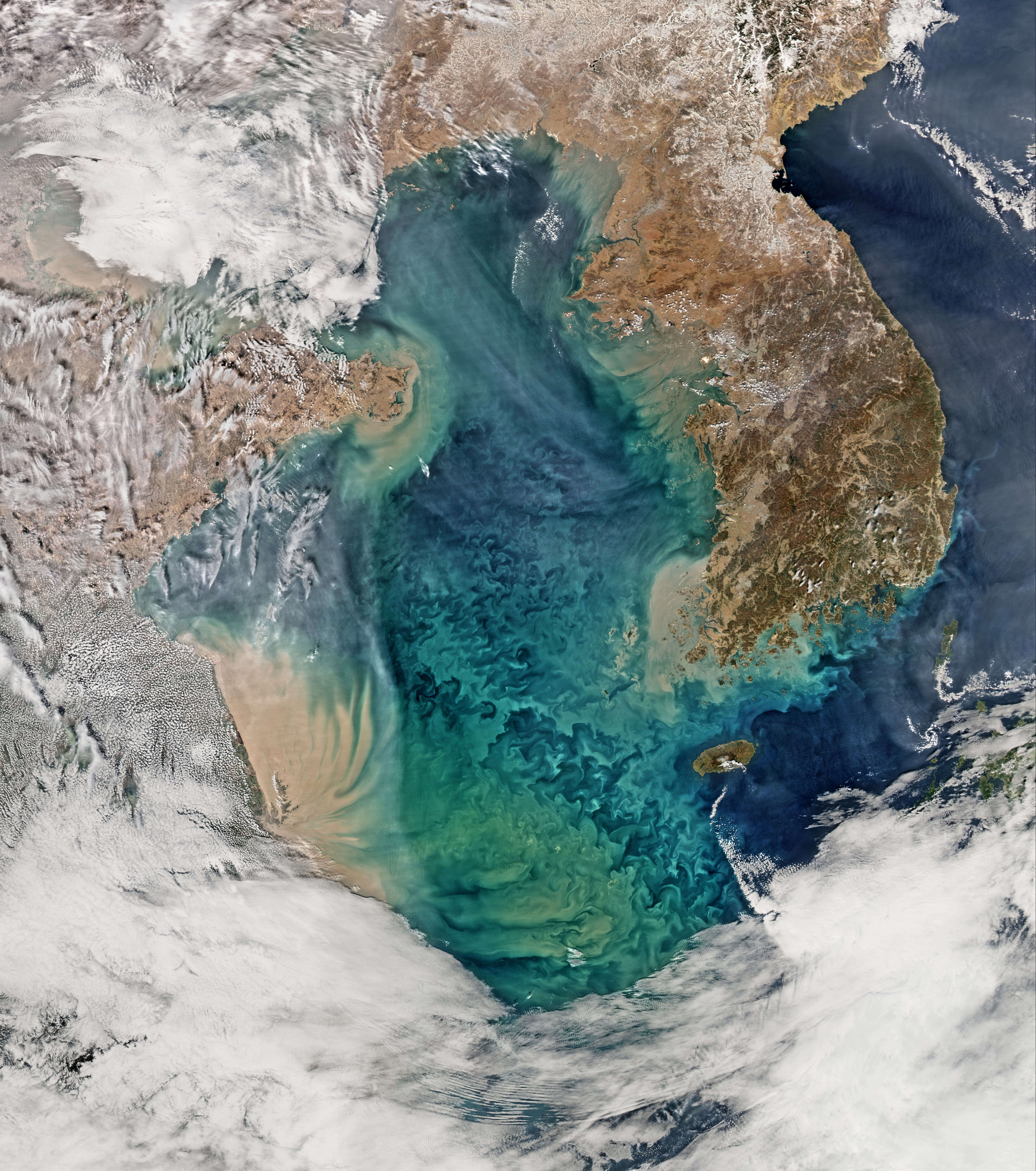 Swirls of Color in the Yellow Sea