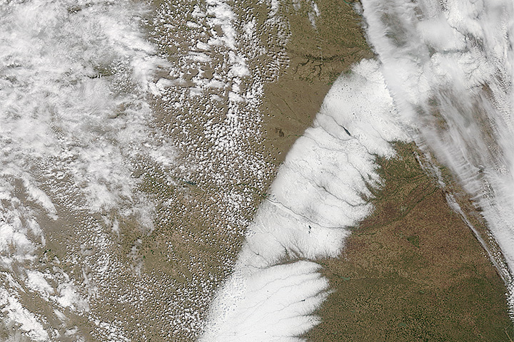 Spring Snow Across the Plains