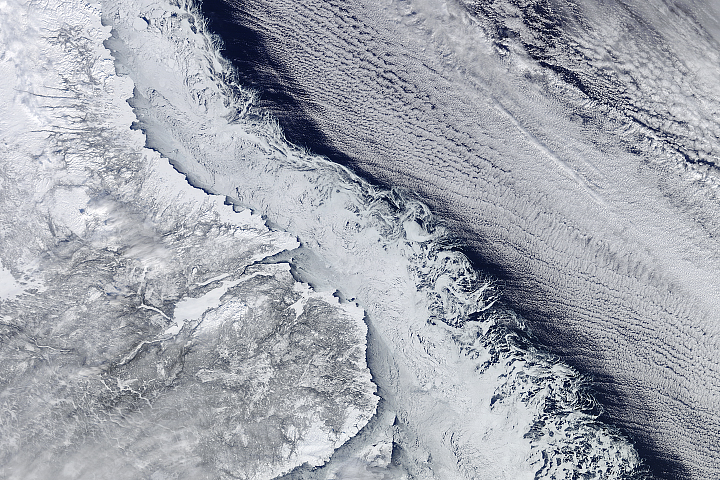 An Intersection of Land, Ice, Sea, and Clouds