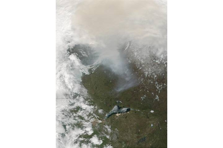 Lake Athabasca, and smoke from fires in Alberta, Canada - selected image